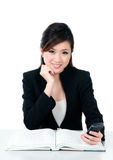 Happy young businesswoman holding cellphone Royalty Free Stock Images