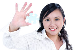 Happy young businesswoman holding jigsaw puzzle Stock Image