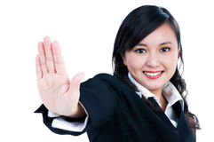 Happy young businesswoman indicating stop gesture Royalty Free Stock Image