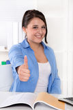 Happy young businesswoman like a trainee with thumb up. Royalty Free Stock Photo