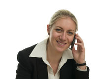Happy young businesswoman on a mobile phone Stock Image