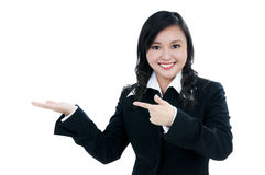 Happy young businesswoman pointing Stock Images