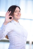 Happy young businesswoman showing ok sign isolated on a white background. Happy young businesswoman showing ok sign on a white background Stock Images