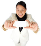Happy young businesswoman showing a white card Royalty Free Stock Photography