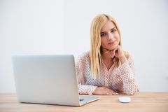 Happy young businesswoman sitting at the table Royalty Free Stock Photo