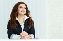 Happy young businesswoman sitting at the table and looking copyspace Royalty Free Stock Images