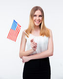 Happy young businesswoman standing with US flag Royalty Free Stock Photos