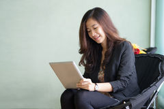 Happy young Businesswoman with a tablet pc Royalty Free Stock Images