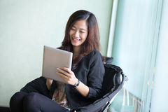 Happy young Businesswoman with a tablet pc Stock Photo