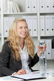 Happy Young Businesswoman With Water In Glass Royalty Free Stock Photography