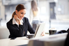 Happy young busineswoman using tablet computer Stock Image