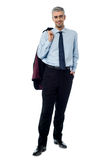 Happy young bussiness man with coat on shoulder Royalty Free Stock Photos
