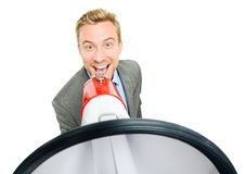 Happy young bussinessman shouting with megaphone on white backgr Royalty Free Stock Image