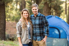 Happy young camper couple looking at the camera Royalty Free Stock Photo