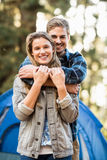 Happy young camper couple looking at the camera Royalty Free Stock Image