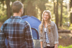 Happy young camper couple looking at each other Stock Photo
