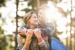 Happy young camper couple looking at each other Royalty Free Stock Photography
