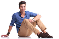 Happy young casual man laying down Royalty Free Stock Photos