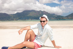 Happy young casual man resting on the beach Royalty Free Stock Photography