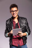 Happy young casual man with tablet Stock Photos