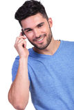 Happy young casual man talking on the phone Royalty Free Stock Images