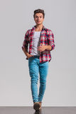 Happy young casual man walking forward Royalty Free Stock Images