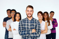 Happy young casual people with arms folded Royalty Free Stock Images