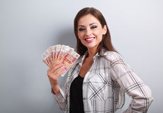 Happy young casual woman holding rubles with toothy smiling on b Stock Photo