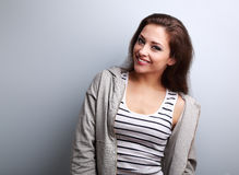 Happy young casual woman with smile on blue background Royalty Free Stock Photos
