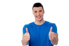 Happy young casula man thumbs up. Successful young man showing double thumbs up Stock Photography