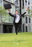 Happy young caucasian businessman jumping Stock Images