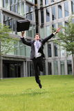Happy young caucasian businessman jumping Stock Photography
