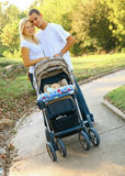 Happy Young Caucasian Couple With Baby In Park royalty free stock image