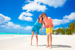 Happy young caucasian couple in sunglasses smiling Stock Image