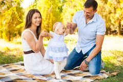 Happy young family spending time outdoor on a summer day, picnic. Happy young caucasian family spending time outdoor on a summer day, picnic in the park. Set royalty free stock photos