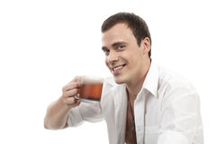 Happy young caucasian guy having a cup of tea Stock Image