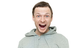 Happy young Caucasian man in gray sports jacket Royalty Free Stock Image