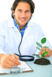Happy Young Caucasian Scientist Analyze Plant Stock Photo