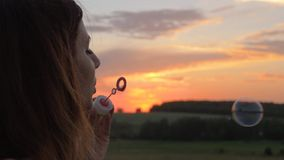 Happy Young Woman Blow Bubbles At Sunset On The Street stock footage