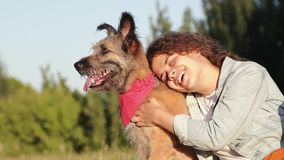 Happy young caucasian woman with her dog at the park at the summertime. stock video