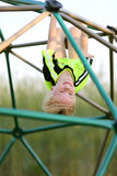 Happy Young Child Climbing Jungle Gym at Playground Stock Photography