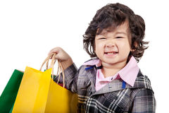 Happy young child holding a bag,  on white. Stock Image