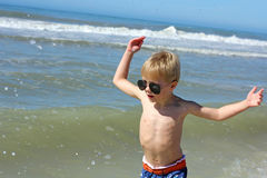 Happy Young Child Playing in the Ocean Stock Image