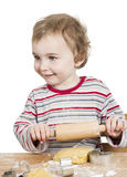 Happy young child with rolling pin in white background Stock Photos