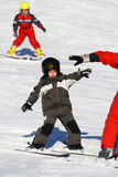 Happy young child skiing