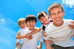 Happy young children outdoors Stock Photos