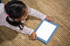 Happy young children using tablet Stock Image