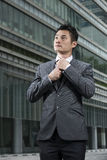 Happy young Chinese business man looking up above him with hope. Stock Photography