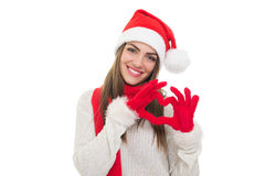 Happy young Christmas woman showing heart with hands Royalty Free Stock Image