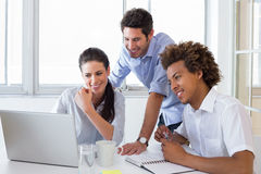 Happy young colleagues working hard Stock Photography